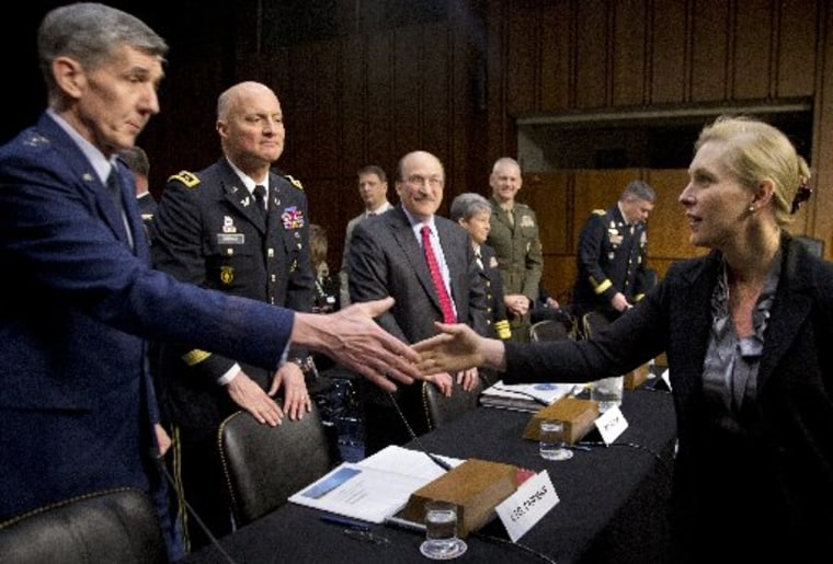 Senate subcommittee on Personnel Chair Sen. Kirsten Gillibrand, D-N.Y., right, greets members of the third panel, from left, Lt. Gen. Richard Harding, Judge Advocate General of the United States Air Force; Lt. Gen. Dana Chipman, Judge Advocate General...