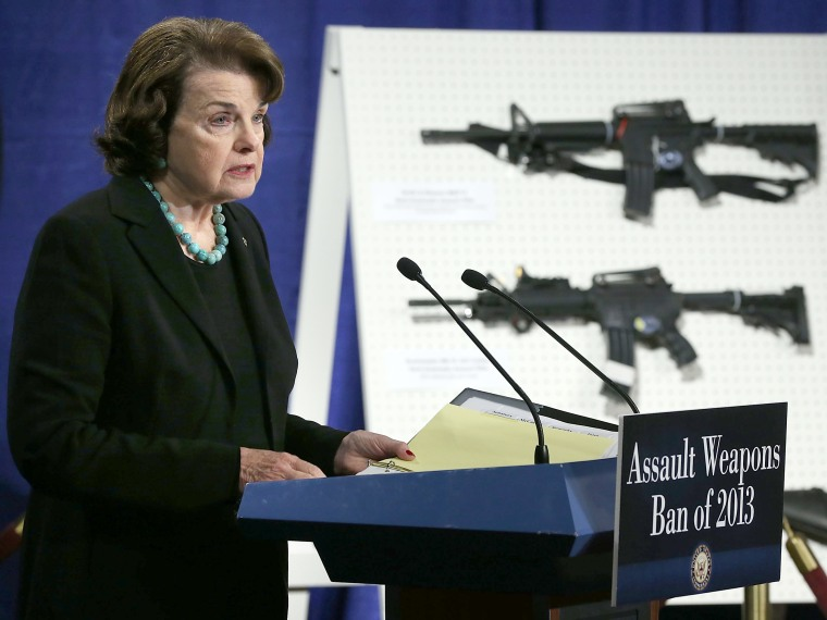 U.S. Senator Dianne Feinstein (D-CA) speaks next to a display of assault weapons during a news conference January 24, 2013 on Capitol Hill in Washington, DC. Feinstein announced that she will introduce a bill to ban assault weapons and high-capacity...