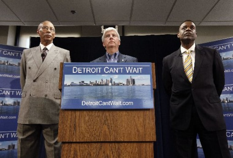 Detroit Mayor Dave Bing, left, Gov. Rick Snyder and Kevyn Orr, right, listen to a question during a news conference in Detroit, Thursday, March 14, 2013. Snyder announced that he had chosen Orr, a partner in the Cleveland-based law and restructuring...