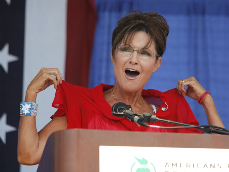 """File Photo: Sarah Palin, former Governor of Alaska and 2008 Republican Vice Presidential candidate speaks at a """"Patriots in the Park"""" Tea Party rally at the Wayne County Fairgrounds July 14, 2012 in Belleville, Michigan. The event was sponsored by..."""