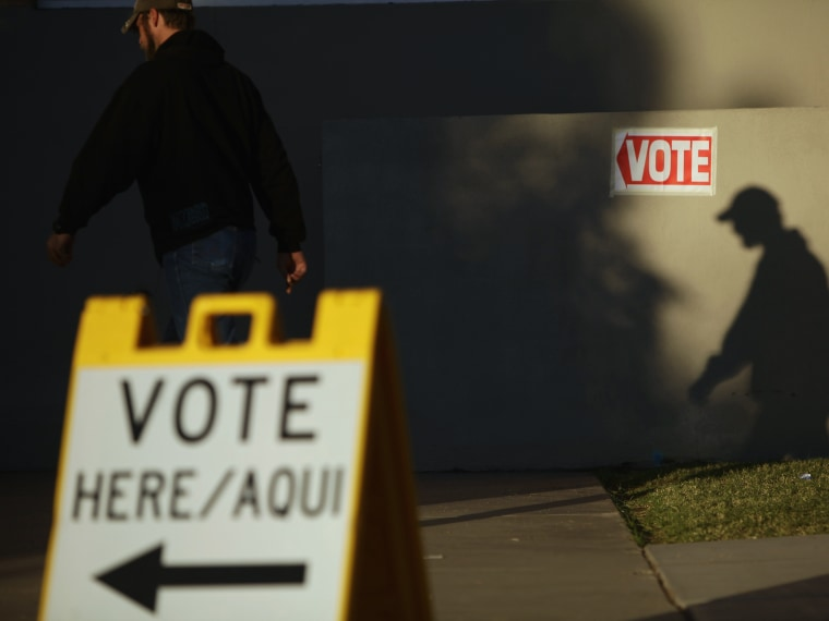 File Photo: A voter casts his shadow on a wall as he arrives at a polling place during the U.S. presidential election in Phoenix, Arizona, in this November 6, 2012 file photo. (Photo by Joshua Lott/Reuters/Files)