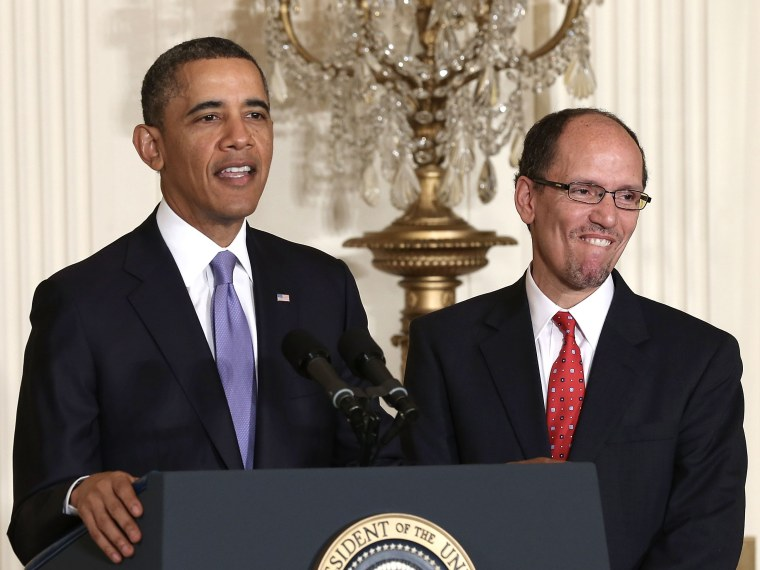 U.S. President Barack Obama (L) speaks as Assistant Attorney General of Justice Department's civil rights division Thomas Perez (R) listens during a personnel announcement March 18, 2013 at the East Room of the White House in Washington, DC. President...