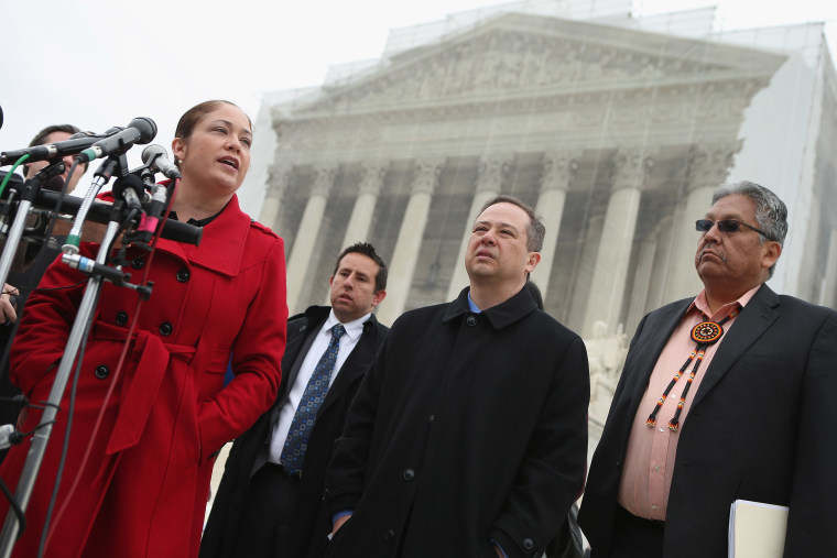 Mexican American Legal Defense and Education Fund Director of Litigation Nina Perales, MALDEF lawyer Luis Figaroa, Georgetown University law professor Jon Greenbaum and San Carlos Apache Tribal Chairman Terry Rambler talk with reporters outside the U.S...