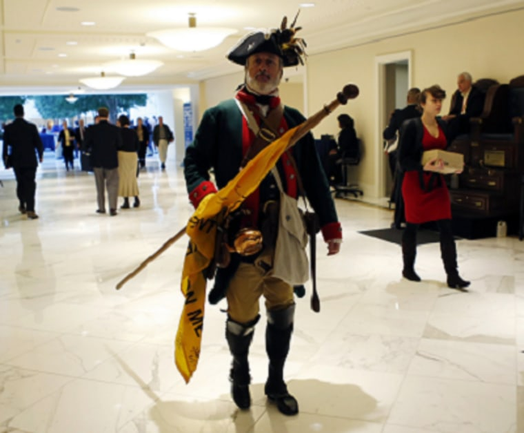 File photo: Tea Party activist William Temple, dressed as a patriot, arrives for the Conservative Political Action Conference (CPAC) at National Harbor. (Photo by: Kevin Lamarque/Reuters)