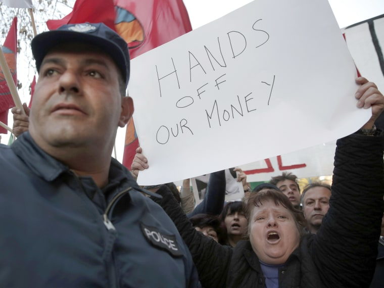 Protesters shout slogans during an anti-bailout rally outside the parliament in Nicosia March 19, 2013. Cyprus's government proposed to spare small savers from a divisive levy on bank deposits but said it expected parliament to reject the measure,...