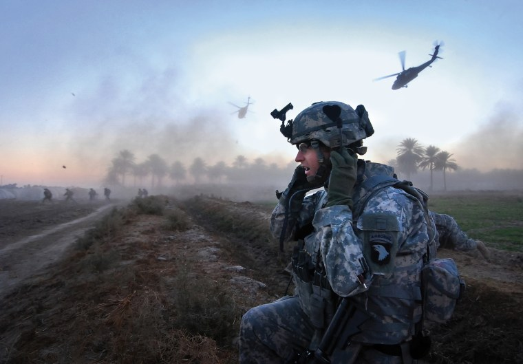 """File Photo: Capt. George Morris, commander of B Company, 2-502 Infantry, and his soldiers  in the opening salvo of Operation \""""Patriot Strike.\"""" The soldiers detained ten suspected al-Qaida conspirators and seized..."""