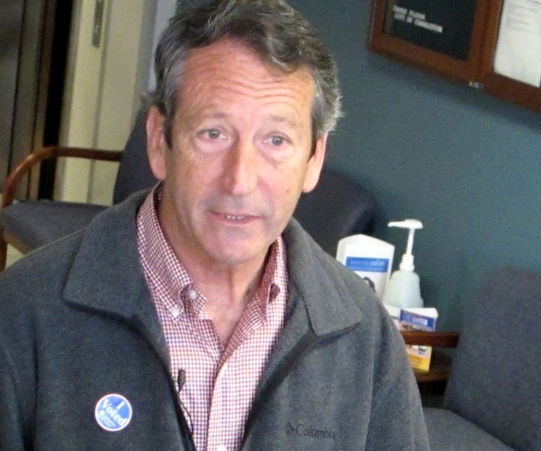 Former South Carolina Gov. Mark Sanford speaks with reporters on Tuesday, March 19, 2013, at a polling place in Charleston, S.C. Sanford, trying to make a political comeback, is one of 16 Republicans running Tuesday in the GOP primary in a special...