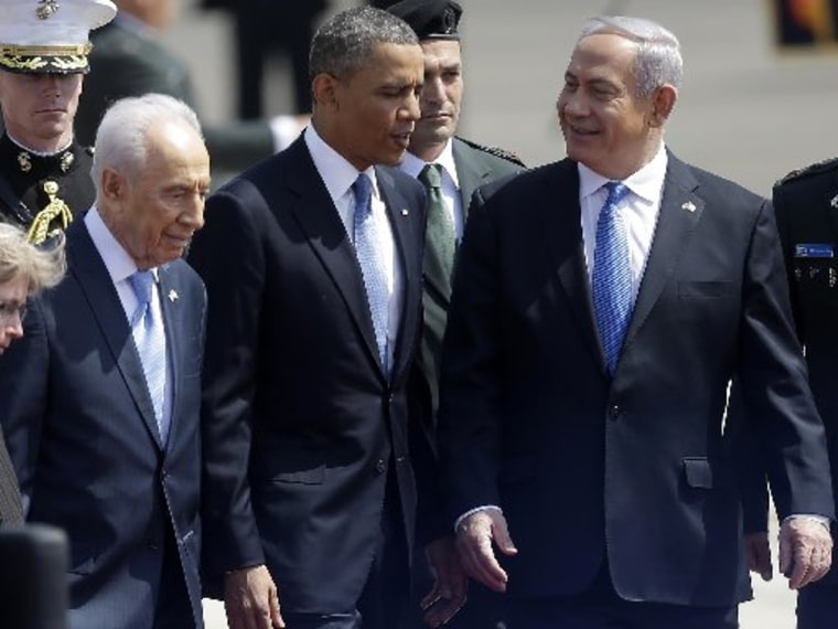 President Barack Obama is greeted by Israeli President Shimon Perez, left, and Israeli Prime Minister Benjamin Netanyahu, right, upon his arrival ceremony at Ben Gurion International Airport in Tel Aviv, Israel, Wednesday, March 20, 2013. (AP Photo...