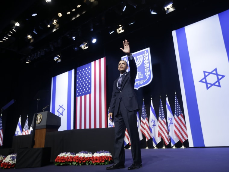 President Barack Obama waves to the crowd after speaking at the Jerusalem Convention Center in Jerusalem, Israel, Thursday, March 21, 2013.  (Photo by Pablo Martinez Monsivais/AP Photo)