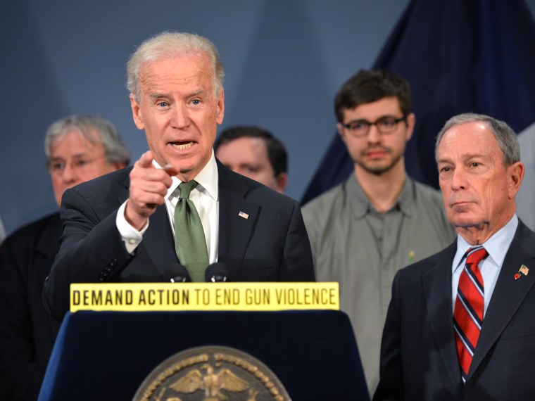 Vice President Joe Biden speaks with New York Mayor Michael Bloomberg as they join families from Newtown, Connecticut to discuss the need for federal gun laws March 21, 2013 at City Hall in New York. (Photo by Stan Honda/AFP/Getty Images)
