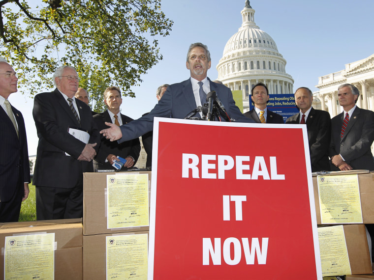 """File Photo: Flanked by conservative lawmakers, Ken Hoagland, chairman of the Repeal It Now.org campaign, center, criticizes President Obama's national heath care plan, often called \""""Obamacare,\"""" Wednesday, Oct. 5, 2011, during a news conference on..."""