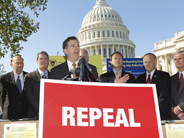 """File Photo: Sen. Jim DeMint, R-SC, center, joins other conservatives lawmakers to criticize President Obama's national health care plan, often called """"Obamacare,"""" Wednesday, Oct. 5, 2011, during a news conference on Capitol Hill in Washington. The..."""