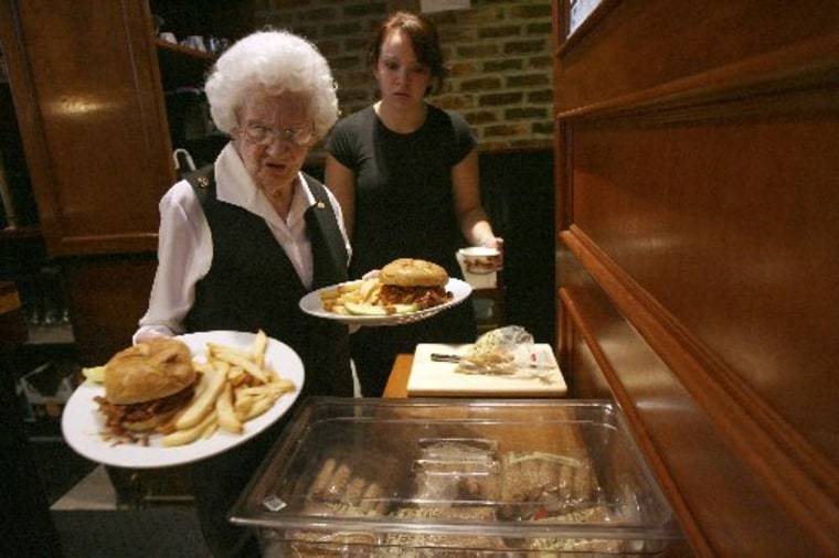 Rose Donaghey, 88, foreground, and Priscilla Adams work during the lunch hour at the Wicked Wolf restaurant in the East Tremont section of the Bronx,  Wednesday, Oct. 15, 2008 in New York.  (AP Photo/Mary Altaffer)