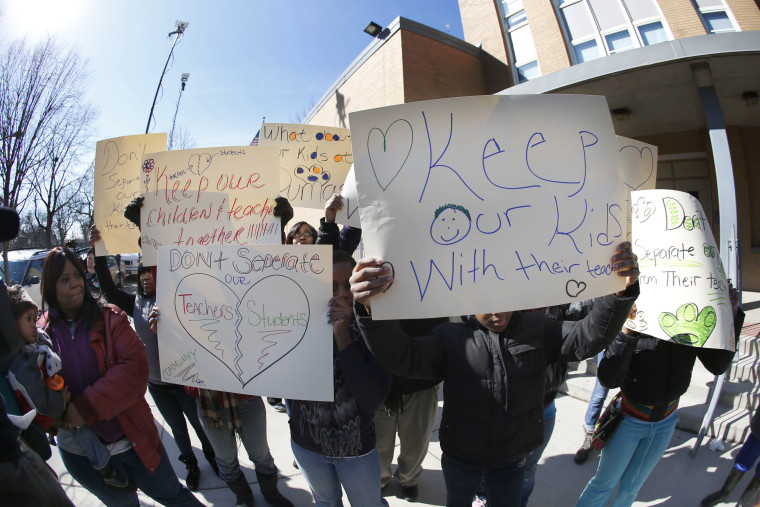 Parents of students at the Dumas Technology Academy Elementary School protest outside the school, the proposed closing of the Southside facility Friday, March 22, 2013, in Chicago. Chicago Public Schools officials ended months of speculation when they...