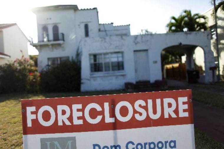 A foreclosure sale sign sits in front of a house in Miami Beach, Florida in this file photo taken February 27, 2009.  (REUTERS/Carlos Barria/Files)