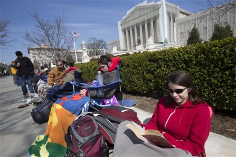 People already are lined up at the Supreme Court for a chance to hear Tuesday and Wednesday's oral arguments on two major same-sex marriage cases. (AP Photo/Jacquelyn Martin)