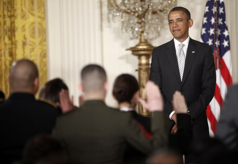 President Barack Obama, watches as the Oath of Allegiance is administered at a naturalization ceremony for active duty service members and civilians, Monday, March 25, 2013, in the East Room of the White House in Washington. (AP Photo/Pablo Martinez...