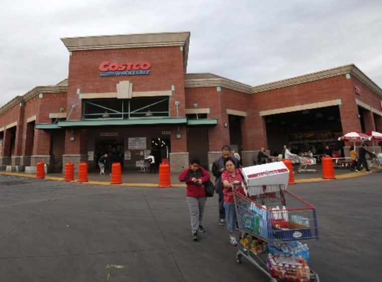 Shoppers push a trolley outside a Costco Wholesale store in Los Angeles, California March 6, 2013. (REUTERS/Mario Anzuoni)