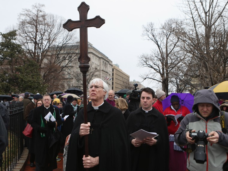Episcopal bishops from throughout the church lead about 100 clergy and lay people in praying the Stations of the Cross as they processed from the White House to the U. S. Capitol March 25, 2013 in Washington, DC. The march was organized 'to challenge...