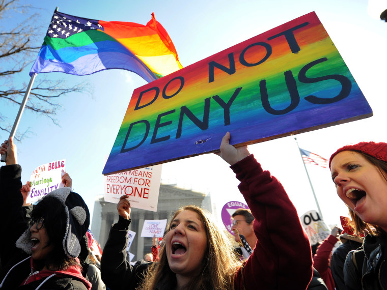 Same-sex marriage supporters shout slogans in front of the US Supreme Court on March 26, 2013 in Washington, DC. The US Supreme Court takes up the emotionally charged issue of gay marriage as it considers arguments that it should make history and...