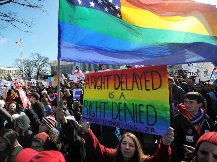 Same-sex marriage supporters shout slogans in front of the US Supreme Court on March 26, 2013 in Washington, DC. (Photo by Jewel Samad/AFP/Getty Images)