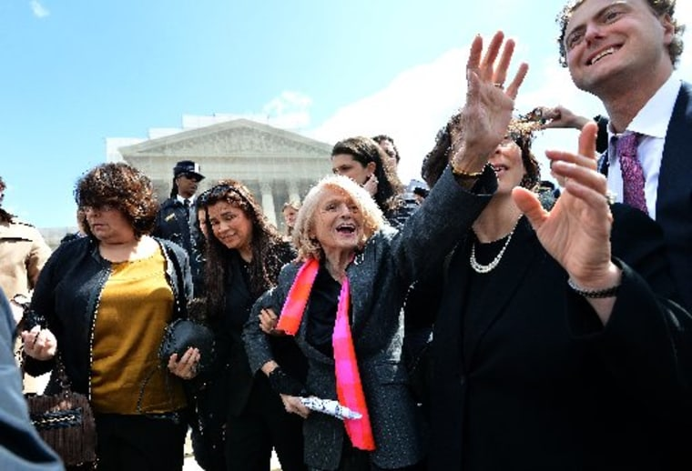 Plaintiff of the US v. Windsor case challenging the constitutionality of Section 3 of the Defense of Marriage Act (DOMA), 83-year-old lesbian widow Edie Windsor (C), greets same-sex marriage supporters as she leaves the Supreme Court on March 27. ...