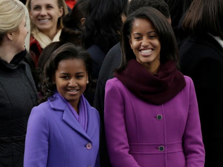Sasha and Malia Obama arrive at the ceremonial swearing-in of their father President Barack Obama at the U.S. Capitol during the 57th Presidential Inauguration in Washington, Monday, Jan. 21, 2013. (AP Photo/Pablo Martinez Monsivais)