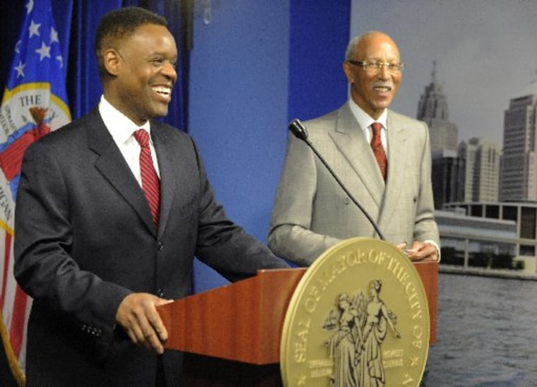 Detroit emergency financial manager Kevyn Orr, left, appears before the media later in the morning Moday, March 25, 2013, in Detroit following Mayor Dave Bing's, right, announcement of a public safety collaboration with local business leaders.  (AP...