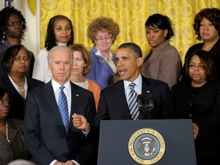 President Barack Obama  speaks while flanked Vice President Joe Biden  and relatives of gun violence victims, in the East Room at the White House, on March 28, 2013. President Obama urged Congress to pass measures such as background checks to protect...