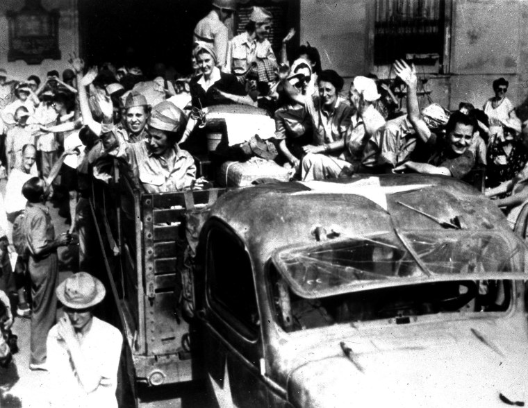 U.S. army nurses, interned since the fall of Corregidor in 1942, wave goodbye to fellow inmates at Santo Tomas, a former Japanese prison camp, in Manila, the Philippines, April 18, 1945. The nurses are returning to their homes and families in the...