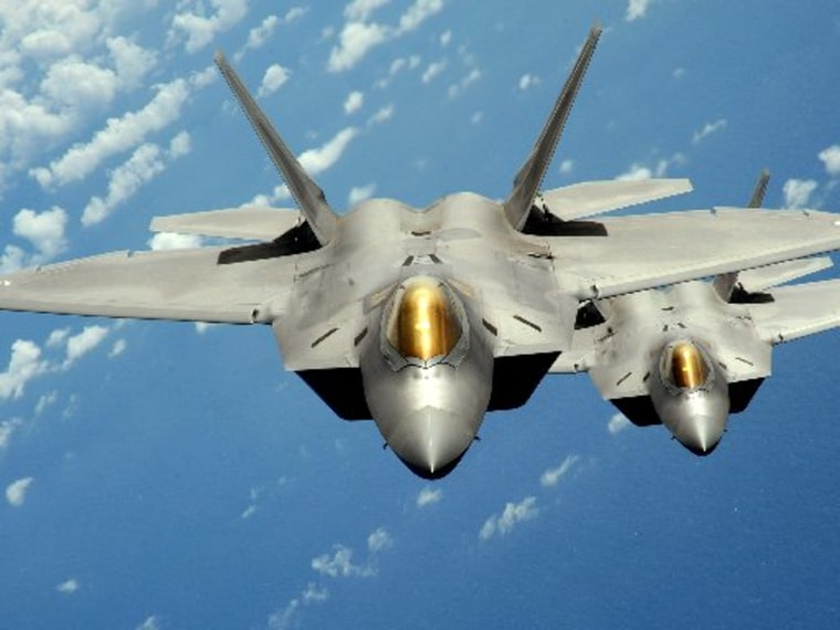 Two U.S. Air Force F-22 Raptor stealth jet fighters fly near Andersen Air Force Base in Guam in this handout photo dated August 4, 2010.   REUTERS/U.S. Air Force/Master Sgt. Kevin J. Gruenwald/Handout