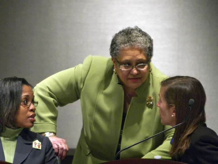 In this file photo taken Jan. 18, 2011 Atlanta Public Schools Superintendent Dr. Beverly Hall, center, speaks with school board member LaChandra Butler Parks, left, and Cecily Harsch-Kinnane, vice chair of the board, right, during the city's specially...