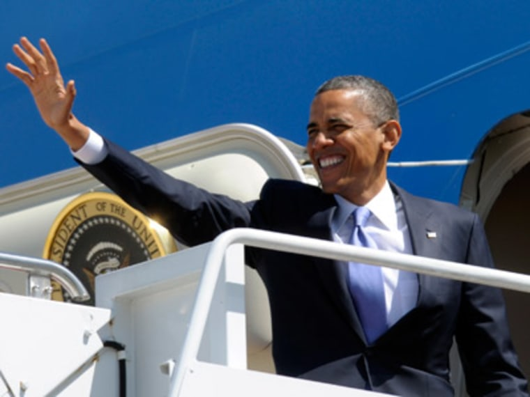President Obama waves from the steps of Air Force One at Andrews Air Force Base in Md. on April 3, 2013. (Photo by Susan Walsh/AP)