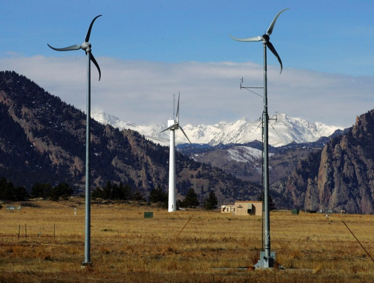Wind turbines at the National Renewable Energy Laboratory Wind Farm are shown in front of snowcapped mountains near Boulder, Colo.