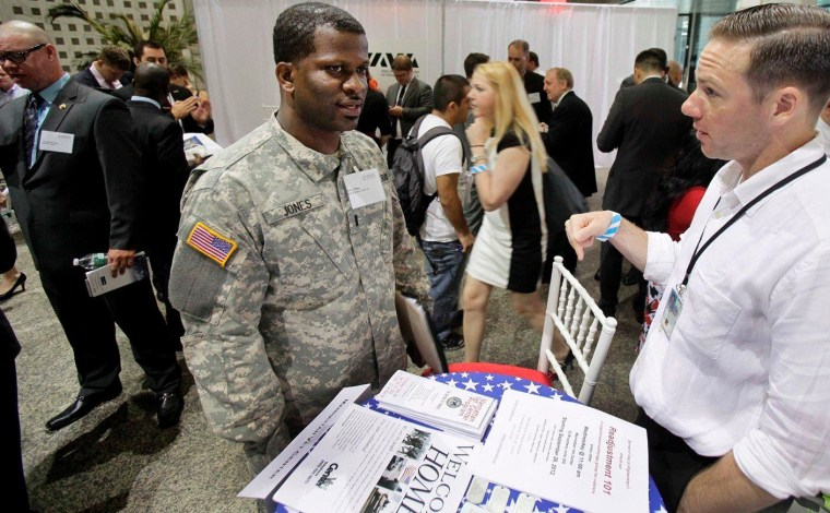 Matthew Desrosiers, right, of the Manhattan Vet Center, confers with Eric Jones, of Clevelend, during the Hiring Our Heroes job fair, part of the second annual VOWS Conference on Veteran Joblessness in New York, Thursday, June 21, 2012.
