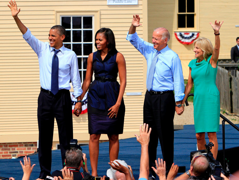 From left, President Barack Obama, first lady Michelle Obama, Vice President Joe Biden and Dr. Jill Biden wave to thousands at a campaign stop, Friday, Sept. 7, 2012, in Portsmouth, N.H.