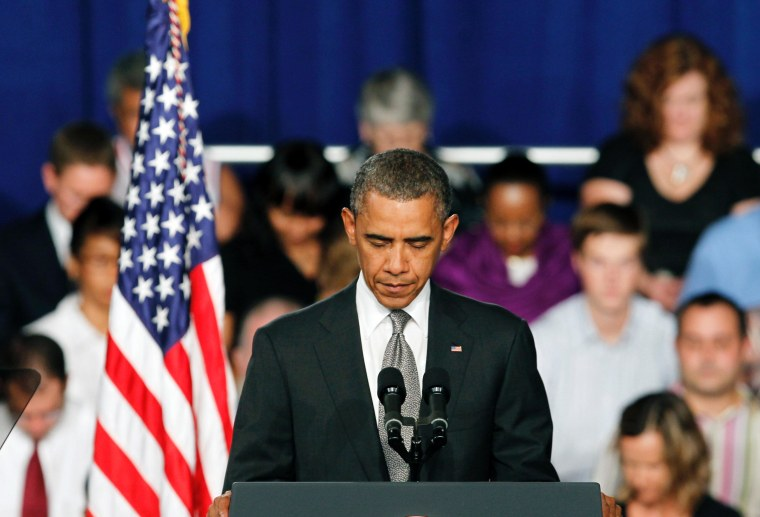 President Barack Obama takes a moment of silence for the events in Colorado during a campaign stop in Fort Myers, Florida.
