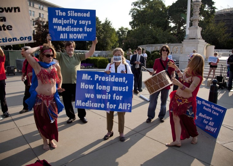A group of belly dancers in favor of Medicare for all perform outside the Supreme Court in Washington, Thursday, June 28.