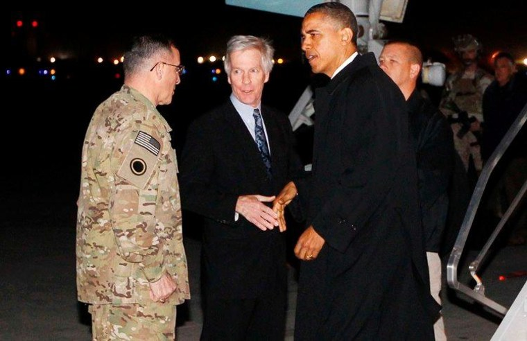 """President Barack Obama is greeted by Lt. Gen. Curtis """"Mike"""" Scaparrotti, and U.S. Ambassador to Afghanistan Ryan Crocker as he steps off Air Force One at Bagram Air Field in Afghanistan, Tuesday, May 1, 2012."""