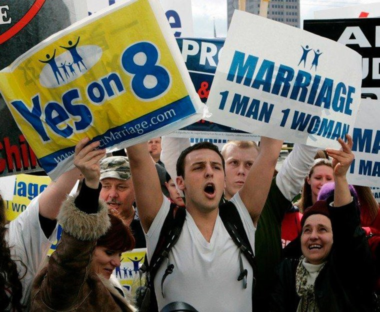 An opponent of Proposition 8, California's voter-approved ban on same-sex nuptials, has his sign blocked by supporters during a demonstration in San Francisco, Thursday, March 5, 2009.