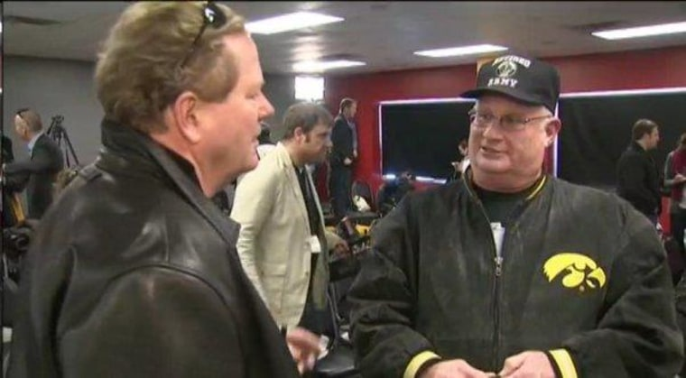 Ed talks with a voter in Newton, Iowa, on Dec. 28, 2011.