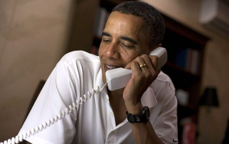 President Barack Obama makes phone calls to 10 American service members stationed around the world from his vacation rental home in Kailua (Dec. 26, 2011).