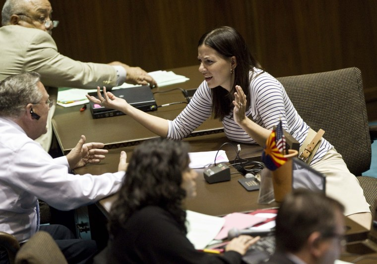 Arizona State Rep. Michelle Ugenti, R- Scottsdale, speaks with Arizona Rep, Russ Jones, R-Yuma, during a legislative session Wednesday, April 6, 2011 at the Capitol in Phoenix. The Arizona Legislature, now pushing to ends its 2011 regular session, is...
