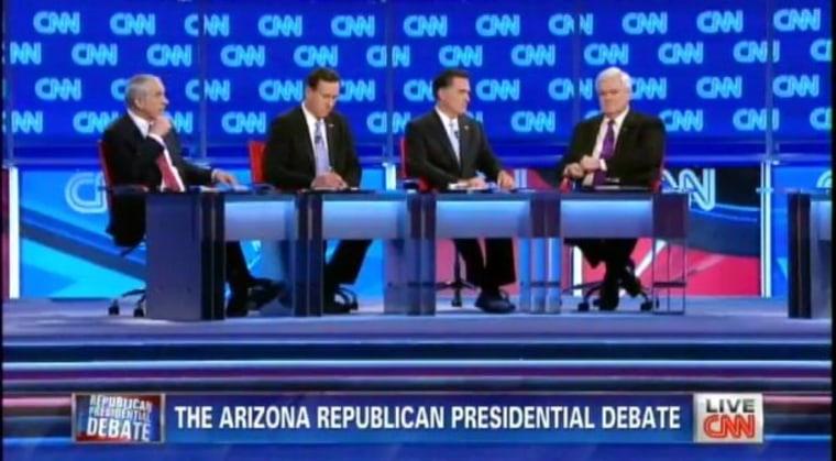 Romney and Santorum swap charges in 20th debate