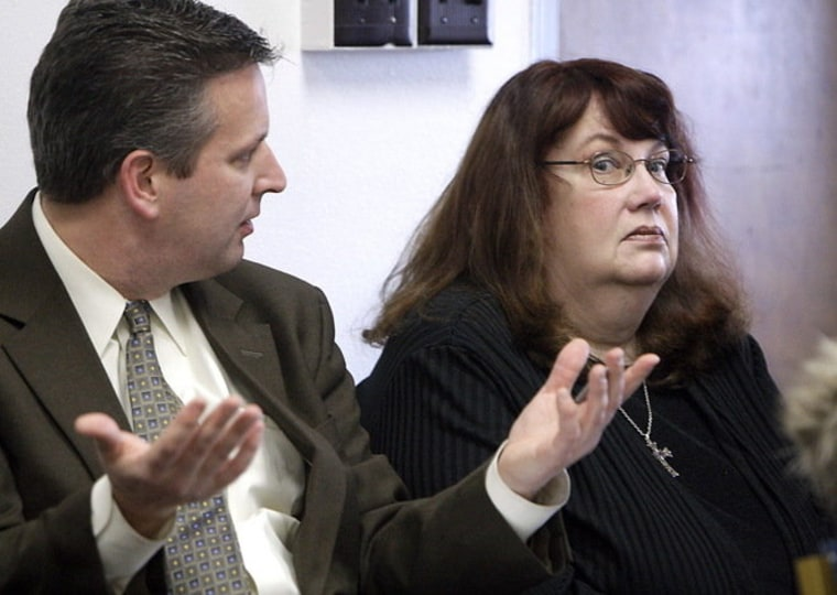 Darlene Wink (right) talks with attorney Peter Wolff before she makes her initial appearance in court at the Safety Building on charges of two misdemeanor counts of using county resources for political purposes.