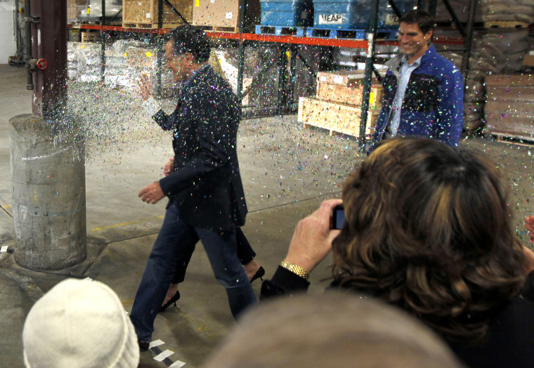 """Mitt Romney gets \""""glitter bombed\"""" at an event in Minnesota on Tuesday."""