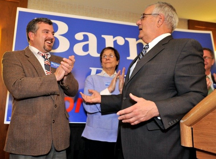 In this Nov. 2, 2010 file photo, Rep. Barney Frank, D-Mass., right, thanks his partner Jim Ready at a party in Newton, Mass., after Frank won re-election in the 4th Congressional District.