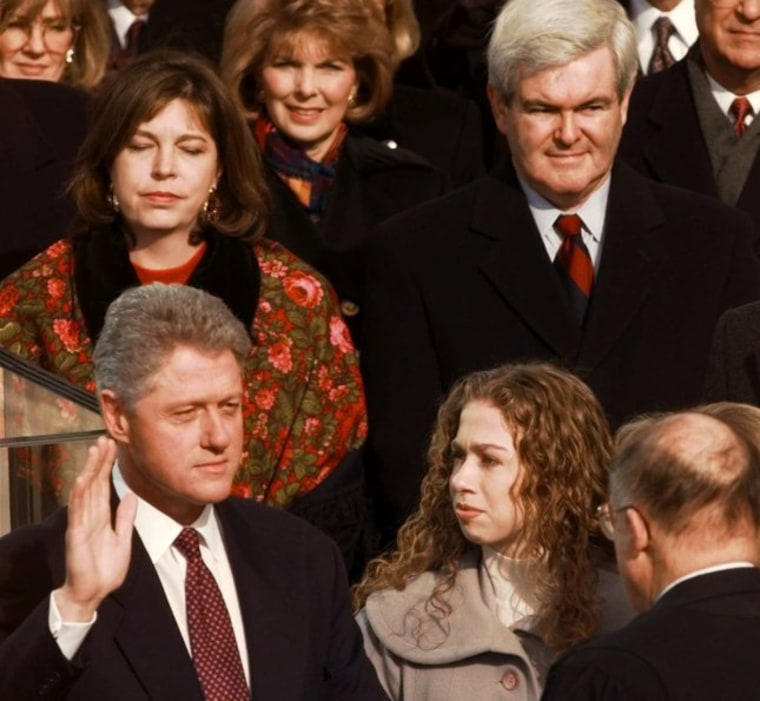 President Clinton is sworn in for his second term by Supreme Court Chief Justice William Rehnquist during the 53rd Presidential Inauguration Monday, Jan. 20, 1997, in Washington.  House Speaker Newt Gingrich and his second wife Marianne are in the...
