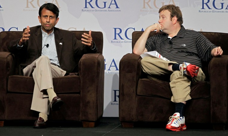 Louisiana Gov. Bobby Jindal, left, speaks as political consultant Frank Luntz listens during a plenary session at the Republican Governors Association annual conference in Orlando, Fla., Wednesday, Nov. 30, 2011.