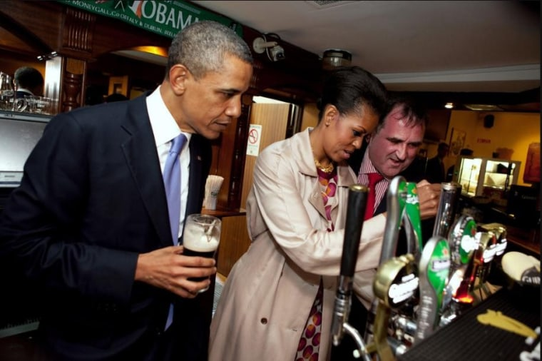 President Barack Obama and First Lady Michelle Obama enjoying a Guinness in Hayes Bar in Moneygall, County Offaly, during their visit to Ireland.